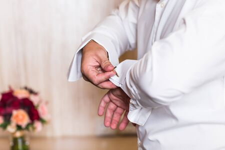 cufflinks: men or groom wear a shirt and cufflinks Stock Photo
