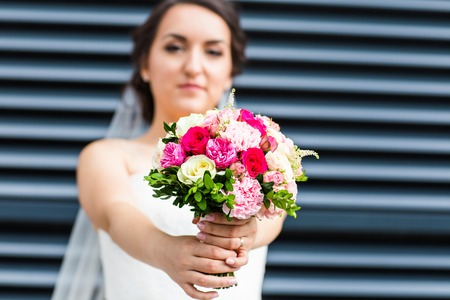 arm bouquet: Beautiful wedding bouquet in hands of the bride.