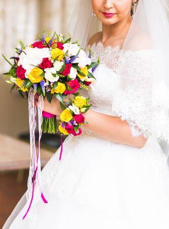 Wedding bouquet of flowers in brides hands