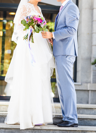married couples: Just married couple outdoors. Wedding couple, newlyweds