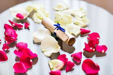 jewry: Paper scroll on the  table with rose petals