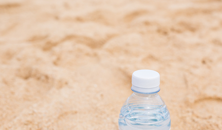lake beach: Bottled water on a hot day at the beach. Stock Photo