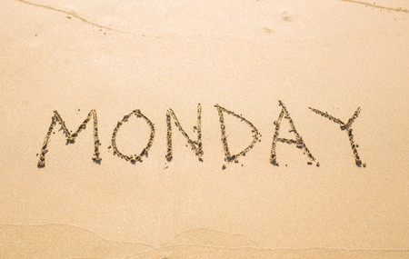 days of the week: Monday - written in sand on beach texture, days week series.