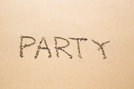 literally: Party on the beach, literally. Word on the beach Stock Photo
