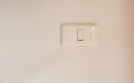 light switch: White light switch and faceplate on white background Stock Photo