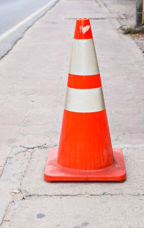 one lane road sign: Orange Street Cone. orange cone with road repairs