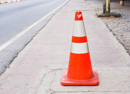 one lane street sign: Orange Street Cone. orange cone with road repairs