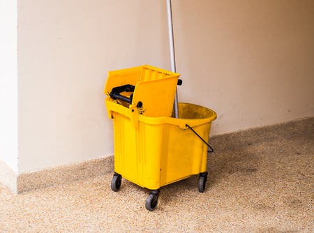 Mop bucket on cleaning in process indoor. Stock Photo