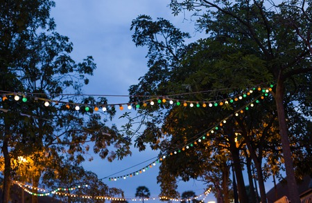 electric avenue: Colorful Christmas illumination in the city street Stock Photo