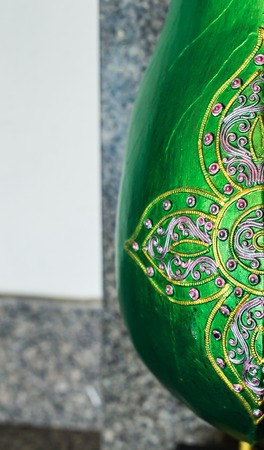 antique vase: Antique traditional green Chinese vase on a room background