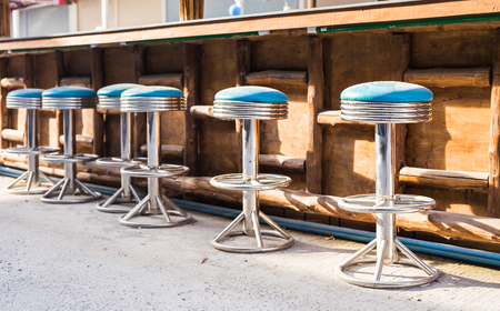 barstool: Cafe bar interior - wooden bar and bar chairs Stock Photo