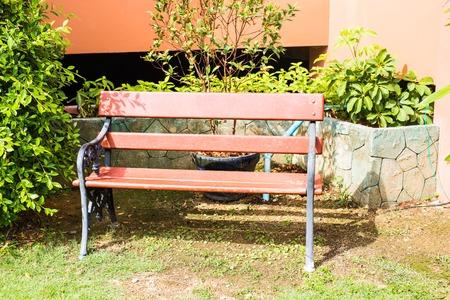 garden bench: Wooden bench in garden. Bench on the street Stock Photo