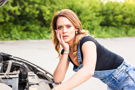 discouraged: discouraged young woman having problems with her car Stock Photo