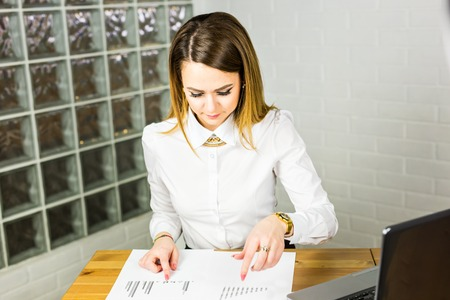 business woman working: Business woman working in office with documents. Stock Photo