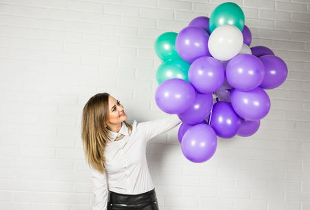 latex woman: Happy young woman with colorful latex balloons, indoor