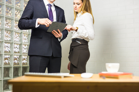 informal clothing: Businesspeople With Digital Tablet Sitting In Modern Office.