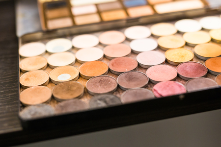 Eyeshadows collection, close up picture of multicolor palettes with eyeshadows