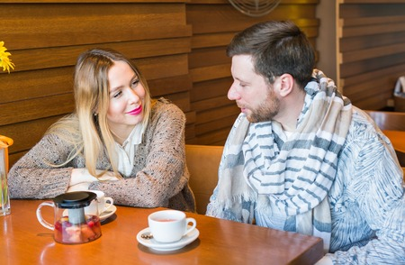 affectionate action: Happy loving couple on date at cafe. Stock Photo