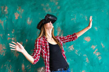 Smile happy woman getting experience using VR-headset glasses of virtual reality at home much gesticulating hands, asian beauty Imagens
