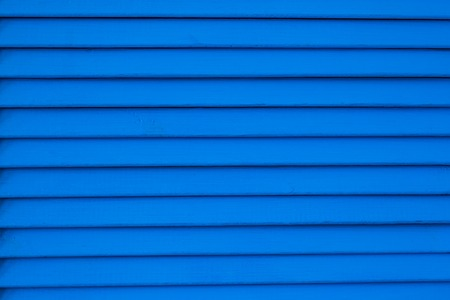 wood blinds: wooden louvers background texture. wood blinds closeup.