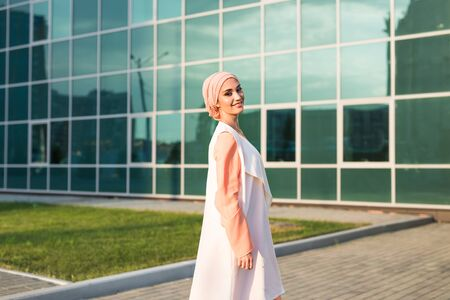 girl in abaya on the background of the business center.