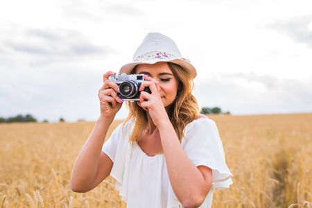 female photographer: female photographer in the field with a camera taking pictures. Stock Photo