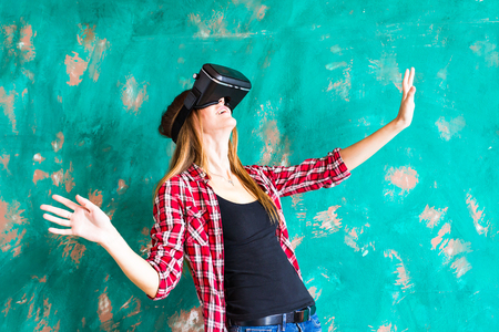 modified: technology, virtual reality, entertainment and people concept - happy young woman with virtual reality headset or 3d glasses Stock Photo