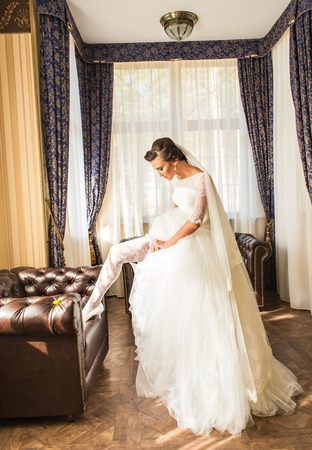 Preparations for the wedding .Bride in a white dress in a romantic scenery