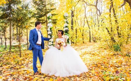 bride and groom in autumn park. Autumn wedding Stock Photo