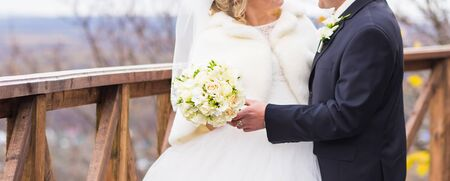 winter wedding: wedding bouquet with roses. winter wedding bouquet.