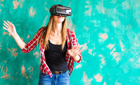 Excited woman watching though the VR device. Stock Photo