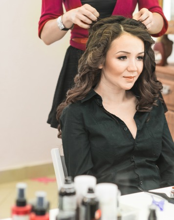 Young bride getting her hair done before wedding. Stock Photo
