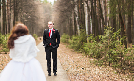 winter wedding: Winter wedding. Beautiful young couple in the woods