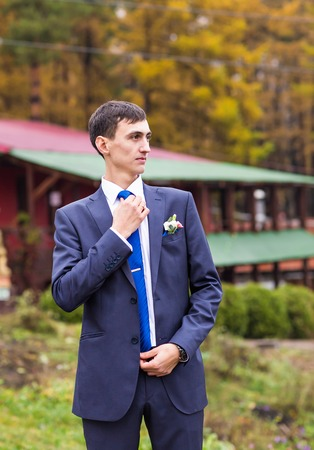 Handsome young man or groom, outdoors portrait