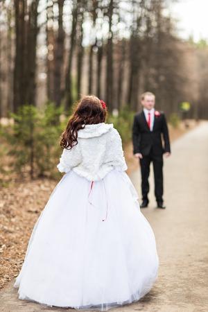 a newly married couple: Newly married couple posing in autumn park