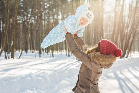 foster parenting: Happy father playing with little child son boy in winter nature. Stock Photo