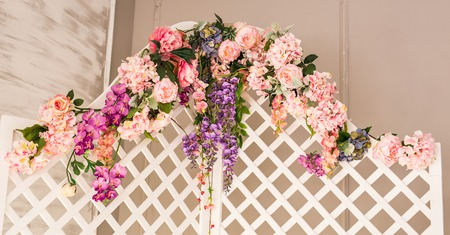 wooden partition: White old fashioned folding screen decorated flowers. Stock Photo