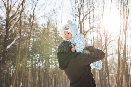 foster parenting: Smiling father with his baby on winter weekend