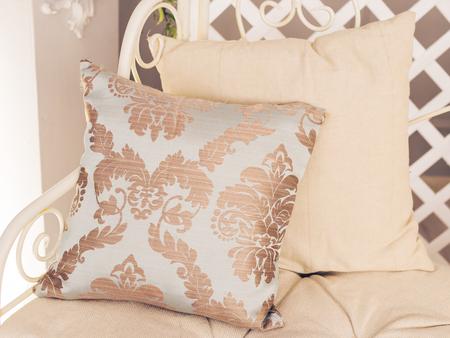 white sofa: Stylish white armchair or sofa with pillows