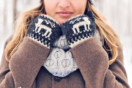 Attractive young woman in wintertime outdoor. Snow and cold.