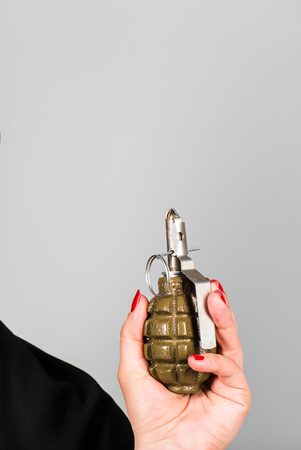woman's hand: Womans hand with grenade. Concept of war