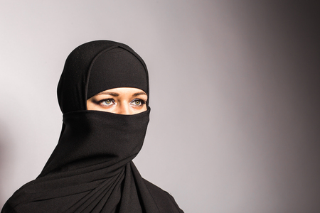 niqab: Young arabian woman in hijab or niqab Stock Photo
