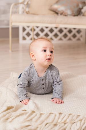 Portrait of little cute baby boy lying