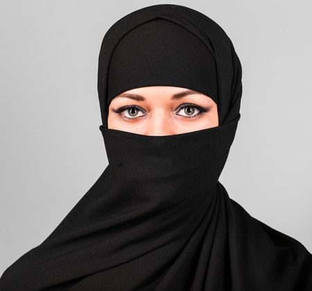 niqab: Muslim woman in niqab. Niqab and saudi Stock Photo