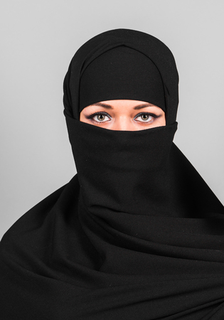 Muslim woman in niqab. Niqab and saudi 免版税图像
