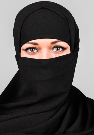niqab: Beautiful Middle eastern woman in niqab traditional veil.