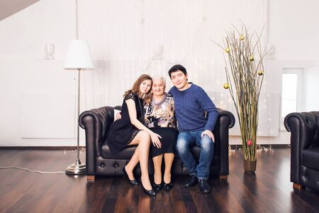 family  room: Beautiful family portrait relaxing at the living room at home. Stock Photo