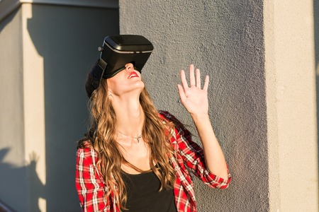 Woman with virtual reality goggles in the city