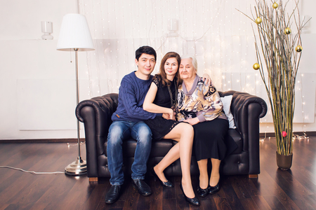 family  room: Beautiful family portrait relaxing at the living room at home