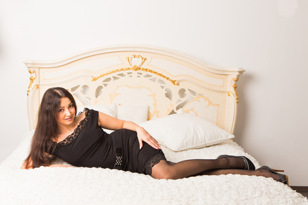 Fashion portrait of young elegant indian woman in bed